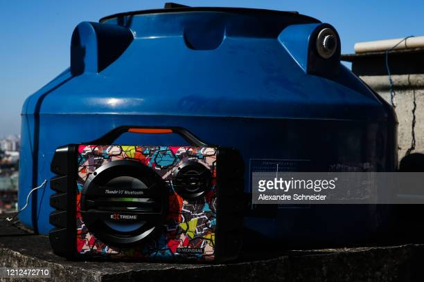 A boombox that Ivan Pereira do Nascimento 39 years old uses to conduct training sessions from the roof of his house to residents of Brasilandia...