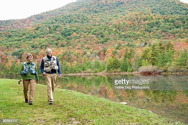 Boomer Couple Walking together with fishing rods