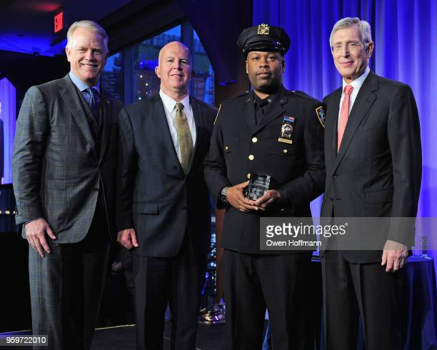 Boomer Esiason James O'Neill Fred Washington and H Dale Hemmerdinger attend the New York City Police Foundation 2018 Gala on May 17 2018 in New York...