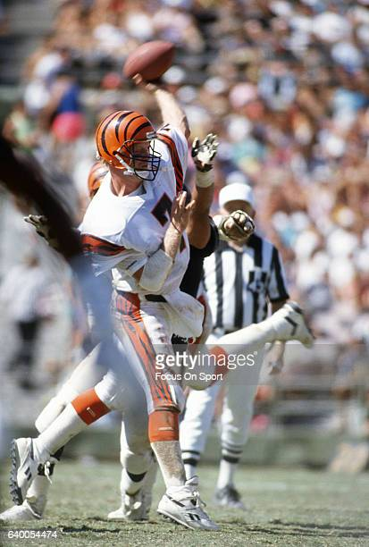 Boomer Esiason of the Cincinnati Bengals throws a pass against the Los Angeles Raiders during an NFL football game December 16 1990 at the Los...