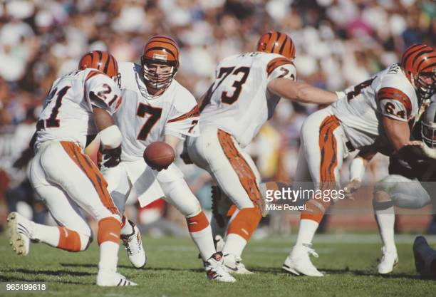 Boomer Esiason Quarterback for the Cincinnati Bengals hands off the ball to Running Back James Brooks during the American Football Conference...