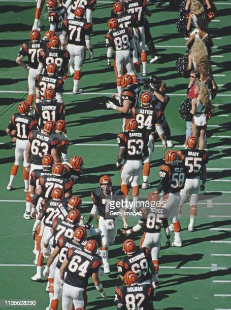 Boomer Esiason Quarterback for the Cincinnati Bengals is greeted by the whole team before the start of the American Football Conference Central game...