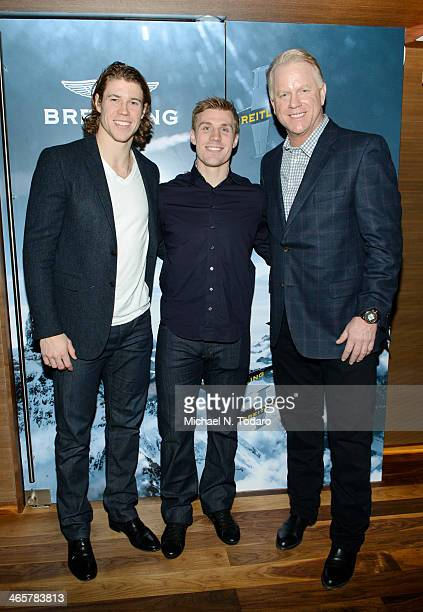 Boomer Esiason with Matt Martin and Casey Cizikas attend the Boomer Esiason Previews Super Bowl XLVIII With Guests At Breitling Boutique New York...