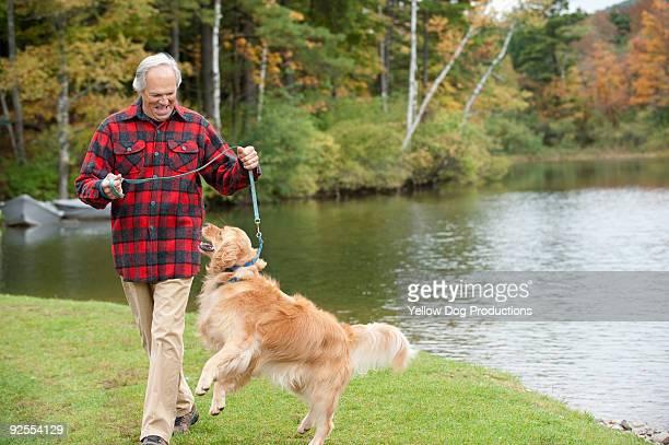 Boomer Man Walking his Dog