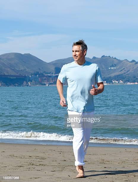 boomer running at the beach