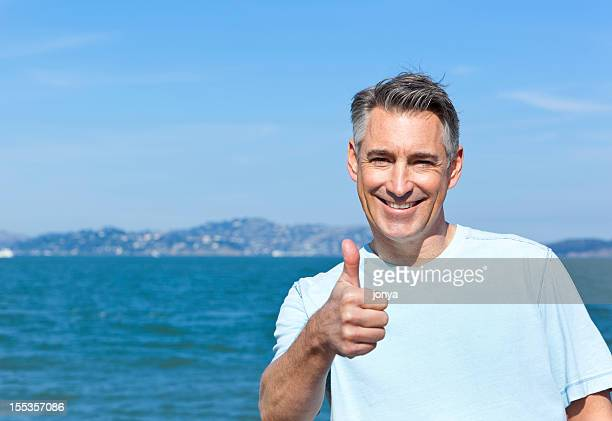 boomer with thumbs up - handsome 50 year old men stock photos and pictures