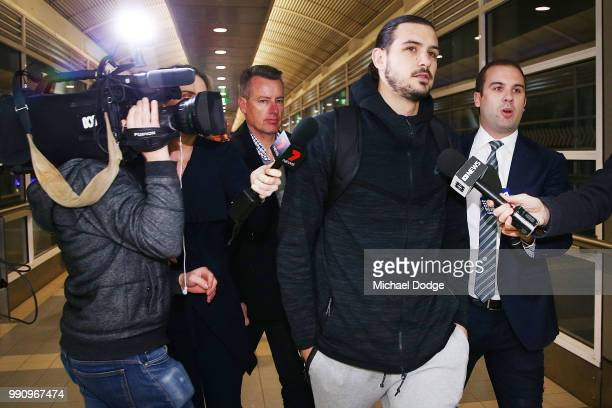 Boomers basketballer Chris Goulding leaves with NBL Communications manager Nick Johnson Melbourne Airport on July 4, 2018 in Melbourne, Australia....