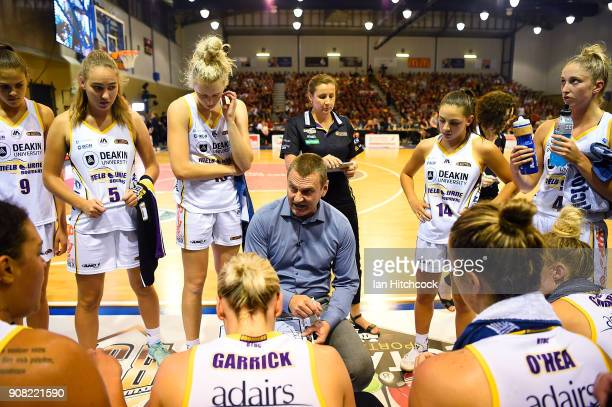 Boomers coach Guy Molloy speaks to his players in a time out during game three of the WNBL Grand Final series between the Townsville Fire and...