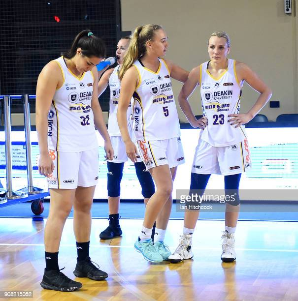 Boomers players look dejected after losing game three of the WNBL Grand Final series between the Townsville Fire and Melbourne Boomers at the...