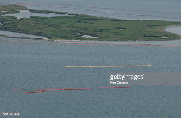 Booms lay in the gulf waters to keep oil off the coast line stemming from the BP Deepwater Horizon oil spill in the Gulf of Mexico Sunday July 11...
