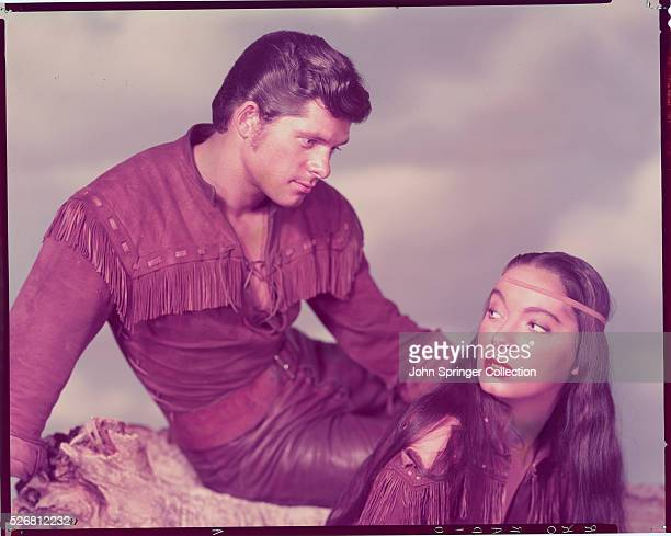 Boone Cardell stares at beautiful Blackfoot princess Teal Eye . The two characters appear in the 1952 film The Big Sky.