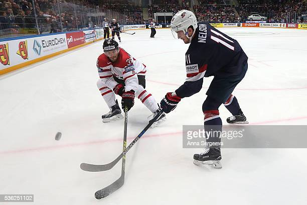 Boone Jenner of Canada and Brock Nelson of USA battle for the puck at Ice Palace on May 21 2016 in Moscow Russia