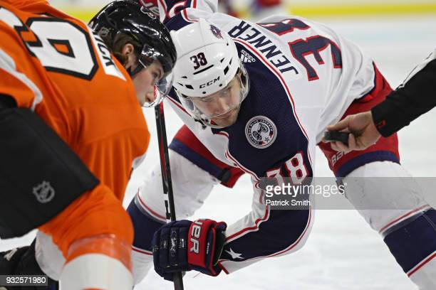 Boone Jenner of the Columbus Blue Jackets and Nolan Patrick of the Philadelphia Flyers faceoff during the first period at Wells Fargo Center on March...