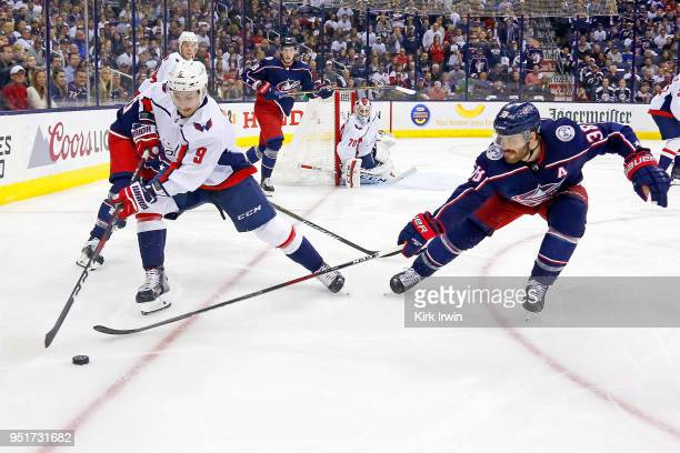 Boone Jenner of the Columbus Blue Jackets attempts to steal the puck from Dmitry Orlov of the Washington Capitals in Game Six of the Eastern...