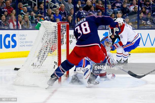 Boone Jenner of the Columbus Blue Jackets beats Charlie Lindgren of the Montreal Canadiens for a goal during the second period on March 12 2018 at...