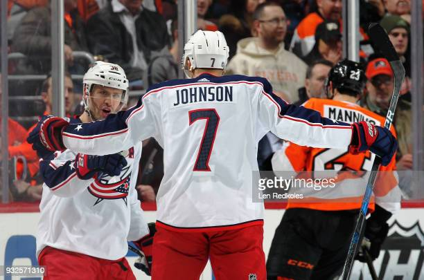 Boone Jenner of the Columbus Blue Jackets celebrates his first period goal against the Philadelphia Flyers with Jack Johnson on March 15 2018 at the...