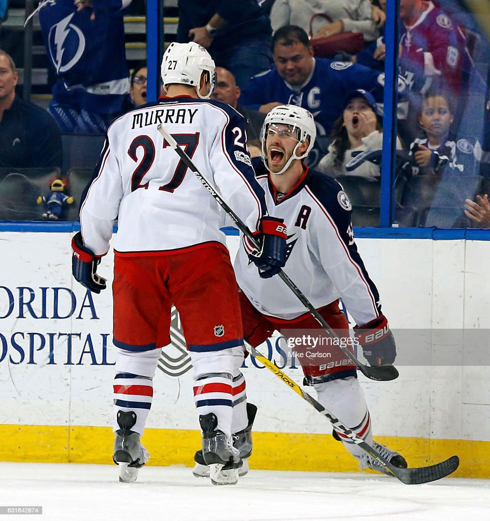 Boone Jenner #38 of the Columbus Blue Jackets celebrates his goal with teammate Ryan Murray #27 against the Tampa Bay Lightning at the Amalie Arena on January 13, 2017 in Tampa, Florida.
