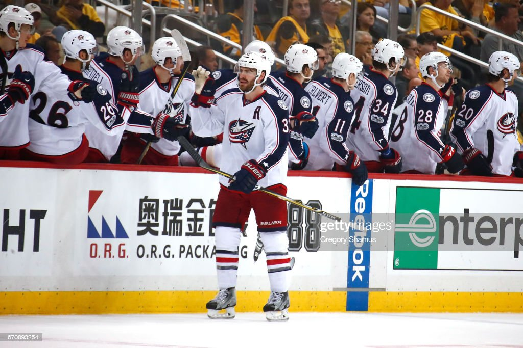 Boone Jenner #38 of the Columbus Blue Jackets celebrates his second-period goal with teammates while playing the Pittsburgh Penguins in Game Five of the Eastern Conference First Round during the 2017 NHL Stanley Cup Playoffs at PPG Paints Arena on April 20, 2017 in Pittsburgh, Pennsylvania.
