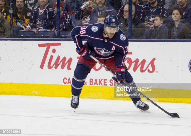Boone Jenner of the Columbus Blue Jackets controls the puck during first period of the game between the Columbus Blue Jackets and the Pittsburgh...