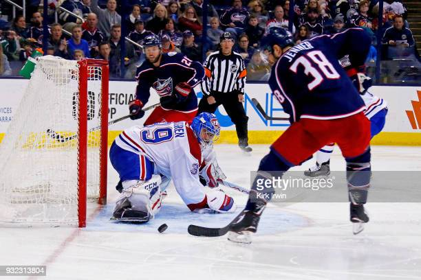 Boone Jenner of the Columbus Blue Jackets flips the puck past Charlie Lindgren of the Montreal Canadiens for a goal during the game on March 12 2018...