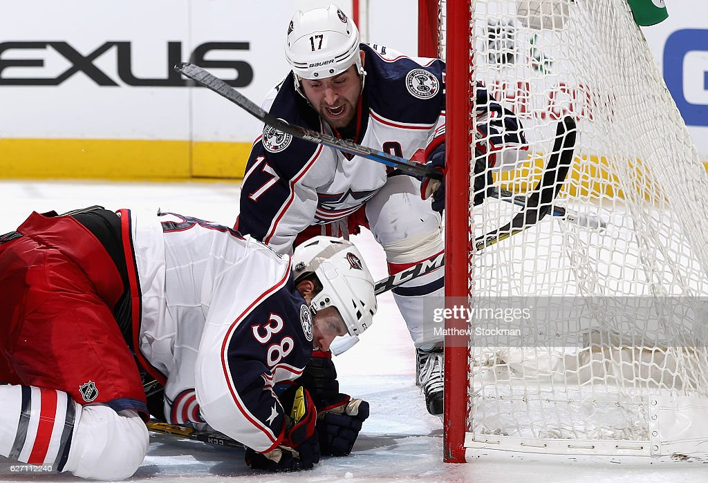 Boone Jenner #38 of the Columbus Blue Jackets is congratulated by Brandon Dubinsky #17 after scoring the go ahead goal against the Colorado Avalanche at the Pepsi Center on December 1, 2016 in Denver, Colorado.