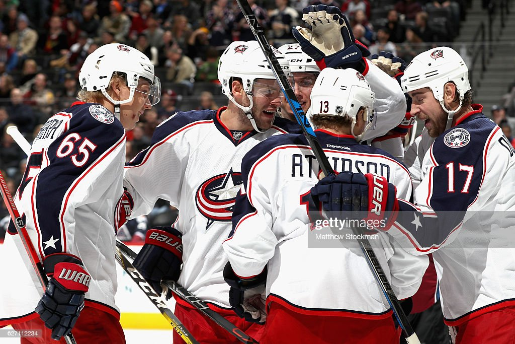 Boone Jenner #38 of the Columbus Blue Jackets is congratulated by his teammates after scoring the go ahead goal against the Colorado Avalanche at the Pepsi Center on December 1, 2016 in Denver, Colorado.