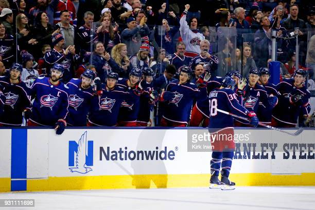 Boone Jenner of the Columbus Blue Jackets is congratulated by his teammates after scoring a goal during the second period of the game against the...