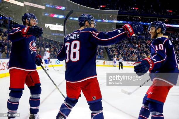Boone Jenner of the Columbus Blue Jackets is congratulated by Alexander Wennberg of the Columbus Blue Jackets and Thomas Vanek of the Columbus Blue...