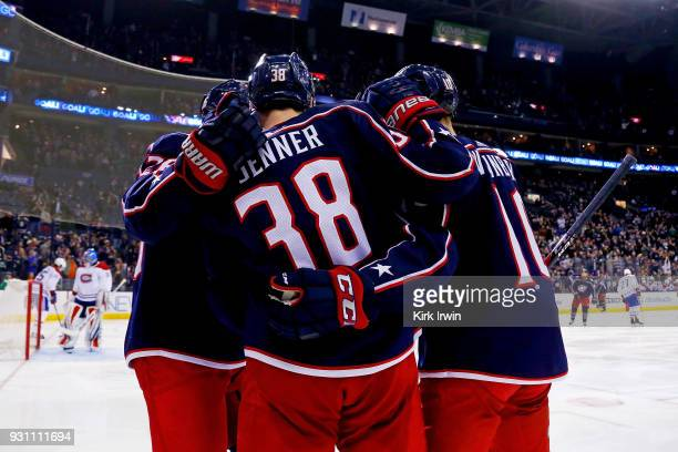 Boone Jenner of the Columbus Blue Jackets is congratulated by Thomas Vanek of the Columbus Blue Jackets and Alexander Wennberg of the Columbus Blue...