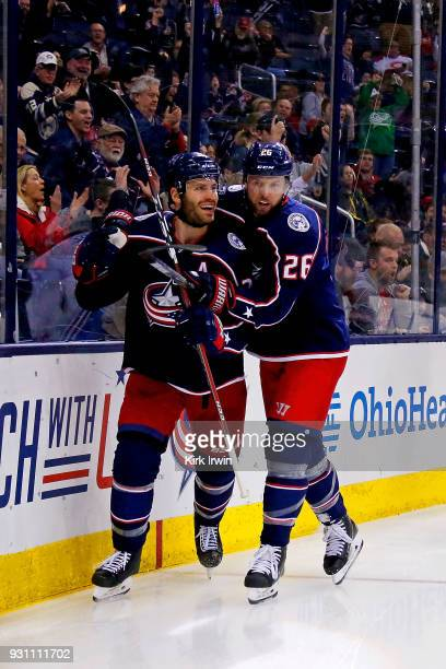 Boone Jenner of the Columbus Blue Jackets is congratulated by Thomas Vanek of the Columbus Blue Jackets after scoring a goal during the second period...