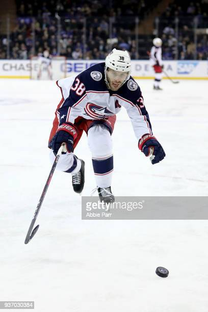 Boone Jenner of the Columbus Blue Jackets reaches for the puck in the first period against the New York Rangers during their game at Madison Square...