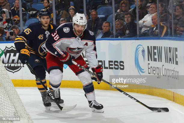 Boone Jenner of the Columbus Blue Jackets skates against Brendan Guhle of the Buffalo Sabres during an NHL game on January 11 2018 at KeyBank Center...
