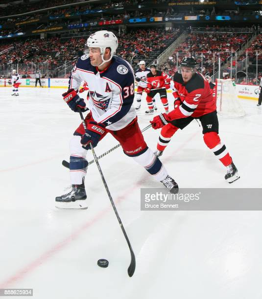 Boone Jenner of the Columbus Blue Jackets skates against the New Jersey Devils at the Prudential Center on December 8 2017 in Newark New Jersey The...