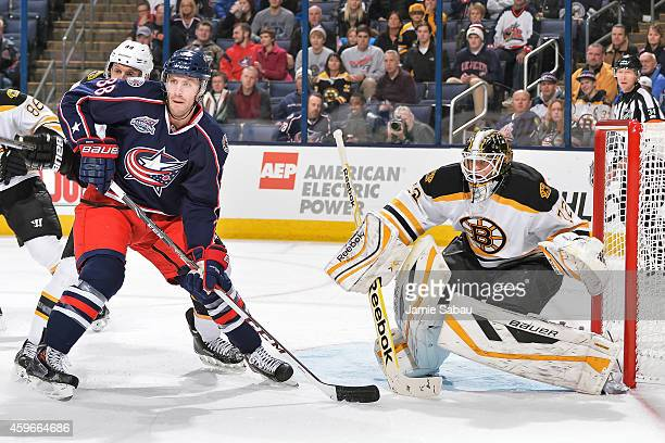 Boone Jenner of the Columbus Blue Jackets skates in front of goaltender Niklas Svedberg of the Boston Bruins on November 21 2014 at Nationwide Arena...