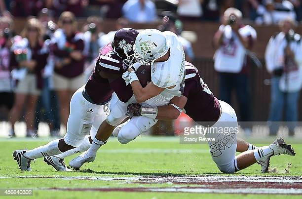 Boone Niederhofer of the Texas AM Aggies is hit by Will Redmond of the Mississippi State Bulldogs during the second quarter of a game at Davis Wade...