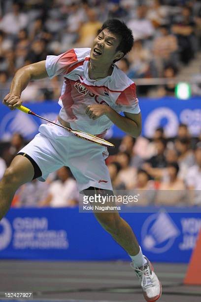 Boonsak Ponsana of Thailand plays a smash against Sho Sasaki of Japan in the men's singles during day two of the Yonex Open Japan 2012 at Yoyogi...