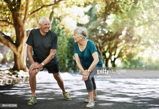 boosting their long-term wellbeing together - warming up stock pictures, royalty-free photos & images