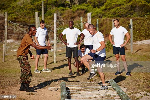 boot camp is tough, but they're tougher - army training stock pictures, royalty-free photos & images