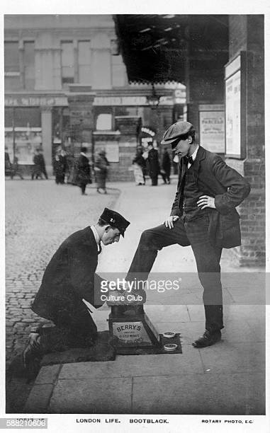 A bootblack at work London Shows a bootblack shining another mans shoes