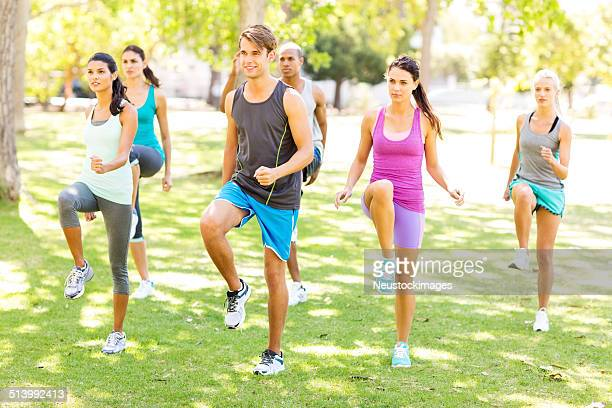 Bootcamp Class Exercising In Park