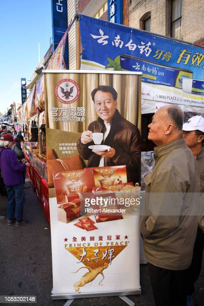 SAN FRANCISCO CALIFORNIA SEPTEMBER 16 2018 A booth at a street festival in Chinatown San Francisco California promotes and sells herbal tea made from...