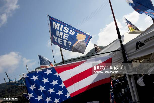 Booth at the fairgrounds flies Trump flag duringf the annual Labor Day parade on September 6, 2021 in Marmet, West Virginia.