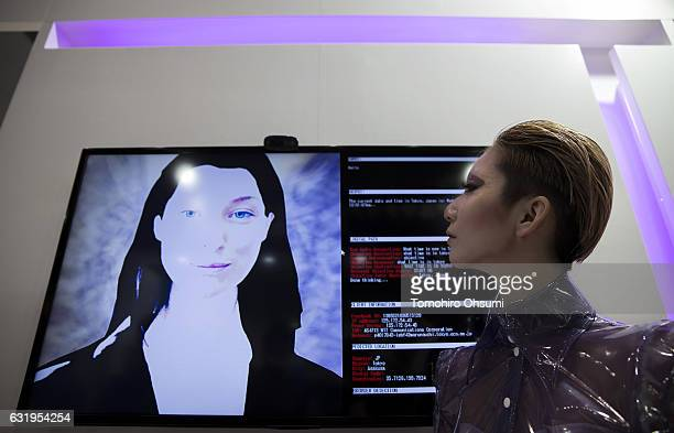 A booth attendant looks at a monitor displaying Luna Ware AI Technologies JP Corporation's artificial general intelligence at the Robodex trade show...