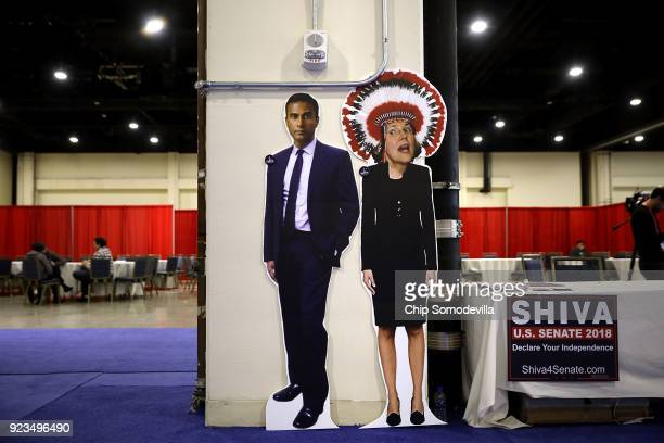 A booth in support of Shiva Ayyadurai who is running against Sen Elizabeth Warren displays an 'Photoshopped' image of Warren wearing a Native...