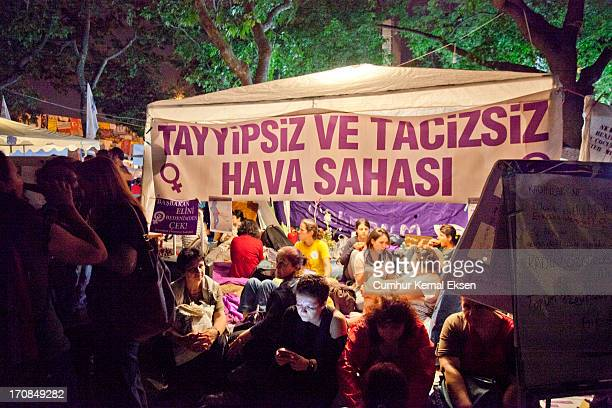 Booth of a feminist group between other tents at Taksim Gezi park demonstrations. The banner reads: Air zone without Tayyip and abuse.