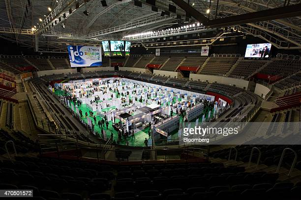 Booths stand in a stadium during a job fair in Goyang, South Korea, on Tuesday, April 21, 2015. South Korea is scheduled to release gross domestic...