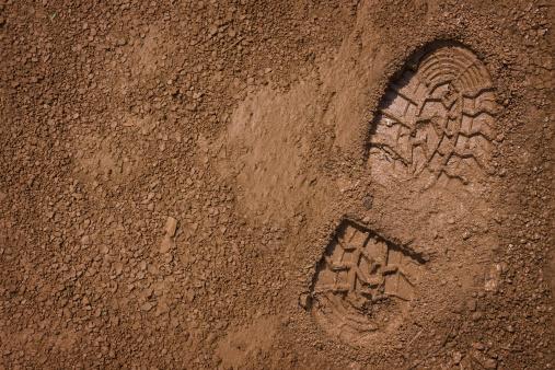Bootprint on mud 152118426