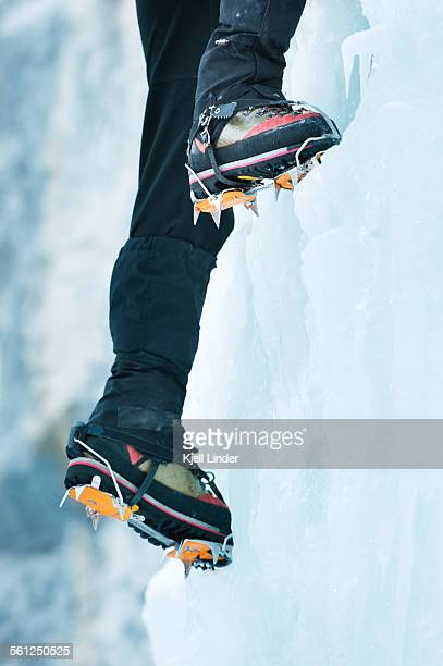 Boots and crampons on ice wall