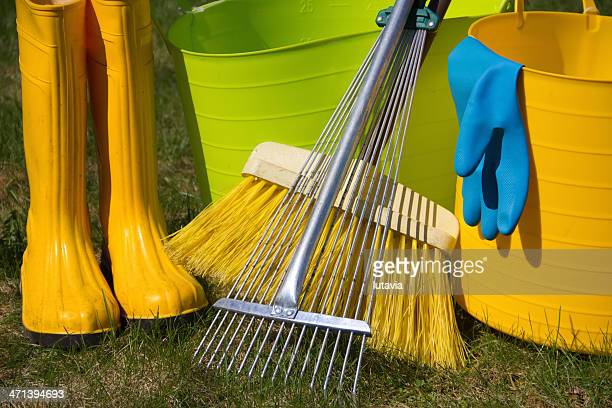 boots and garden tools on grass - lutavia stock pictures, royalty-free photos & images