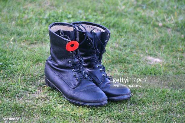 Boots and poppies are dropped off the lawn during a commemoration ceremony at the Canadian National Vimy Memorial in Vimy near Arras northern France...